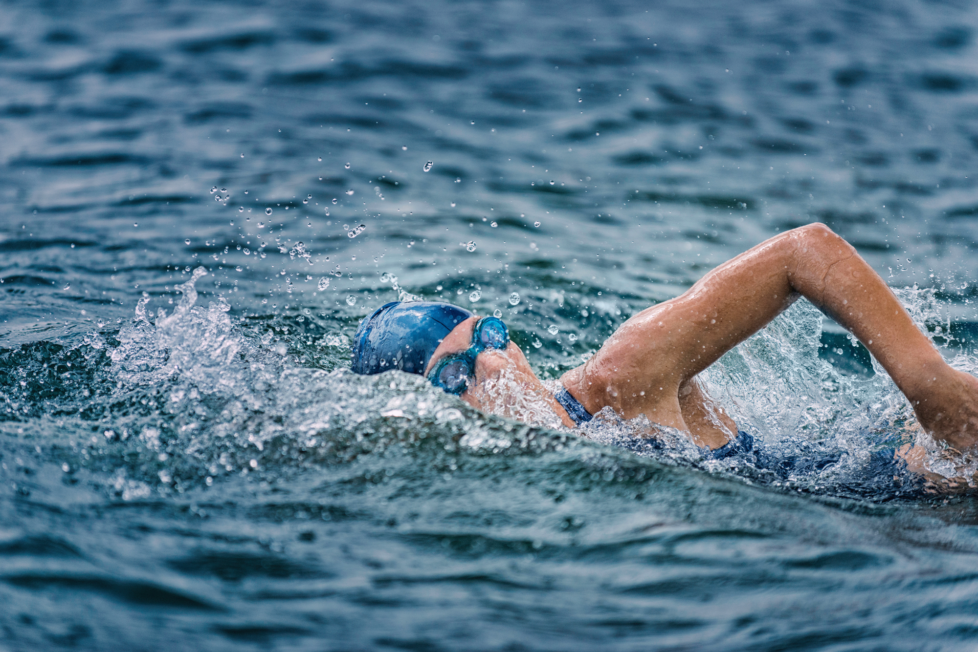 Open water swimming - female athlete swimming long distance
